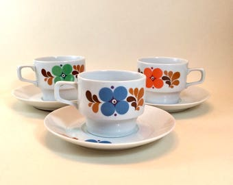 Set of three seventies Colditz porcelain coffee cups and saucers with retro flower decor. Made in GDR/Eastern Germany