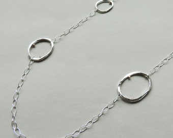 Allium Necklace, shiny silver long necklace with minimal gold dot accents for everyday wear.