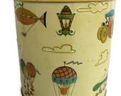 vintage storage tin with colorful hot air balloons, old timey cars and lamp posts