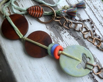Change in the Wind- blue green ceramic butterfly. orange ceramic leaf. wood disc beads. multi strand assymetrical necklace. Jettabugjewelry