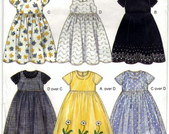 New Look 6850 Non-Vintage Pattern Kids Dresses And Robes - Six Sizes In One