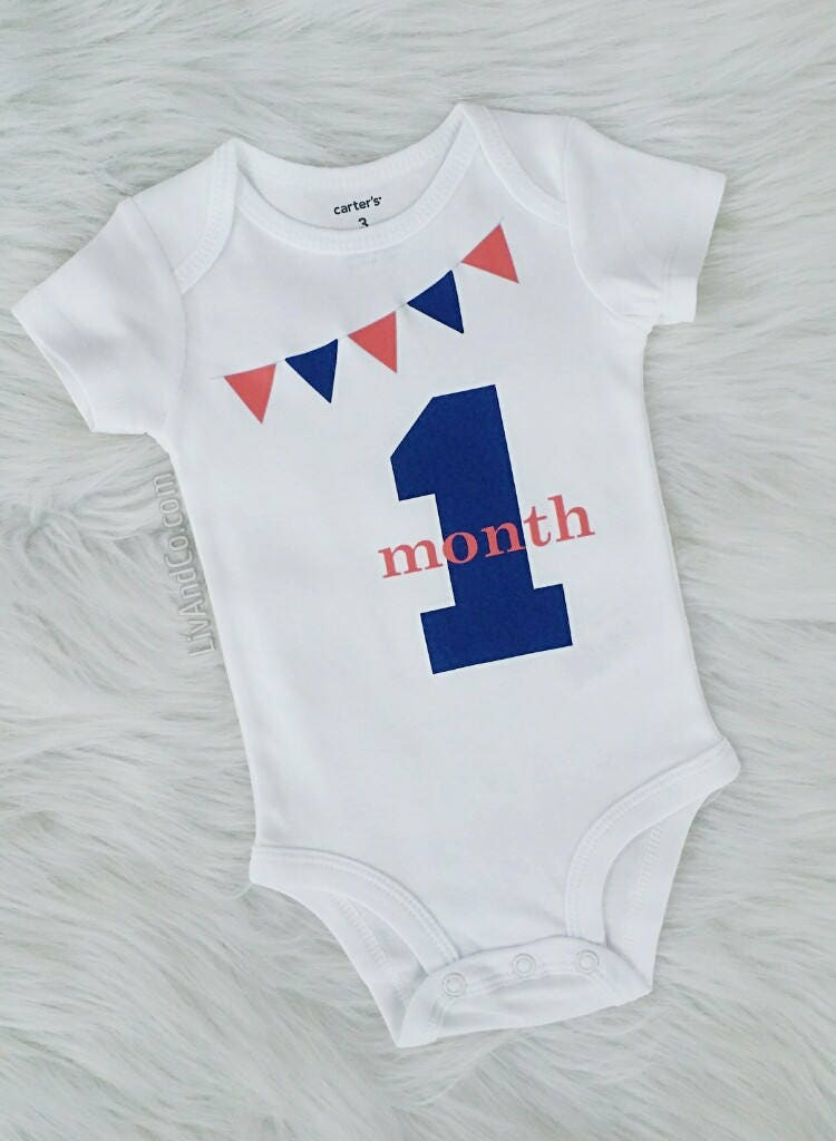 Baby Boy Clothes, Baby Girl Clothes, Baby Clothing, 1 Month Old Baby, Baby Gift, Baby Picture Outfit, Baby One Month Milestone, Liv & Co.™ Liv & Co.™ is home to the original banner milestone baby outfits & this navy blue & coral 1 month old baby boy or girl milestone romper outfit.