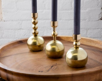 The Ellipses Candlesticks in hand-polished raw brass.