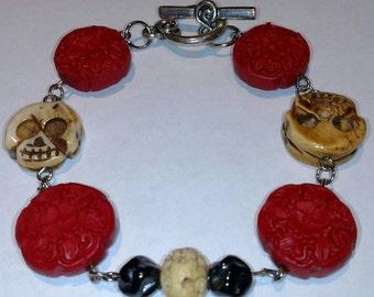 Carved Skulls and Cinnabar Bracelet