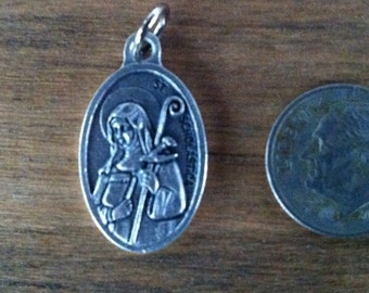 St. Scholastica holy medal - patron saint against lightning and storms. Catholic. religious.
