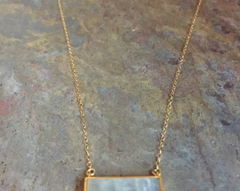 Gold necklace with moonstone pendant