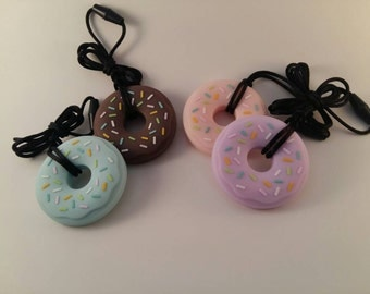 Silicone Donut Teether/Pendant with cord and clasp.