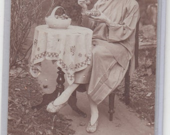 Undivided Back  Antique Postcard-Elegant Woman Sitting In Her Garden Eating Grapes Wearing Silk Slippers  Must See