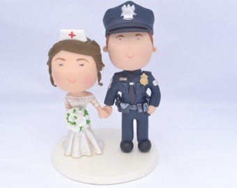 Couple holding hands. Police Officer and Nurse. Handmade. Fully customizable. Unique keepsake. Custom cake topper.