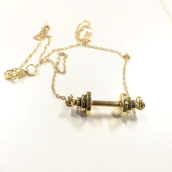 Gold coloured barbell / dumbbell weight lifting necklace