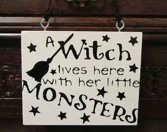 A witch lives here with the little monsters. Real wood, solid beech wooden hanging plaque. Witch sign. Witch plaque. Xmas. Halloween.