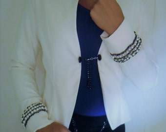 Suede white blazer with pearls and chain strap on the sleeve**
