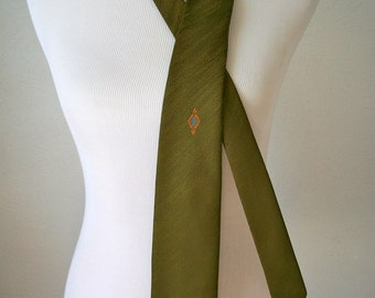 Slender 60s olive green tie with minimal pattern by Trevira