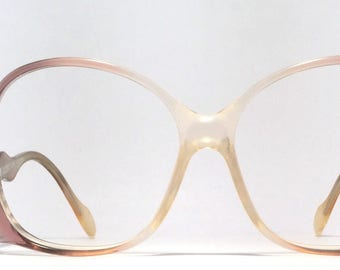 Vintage eyewear. Unique Style. Fabulous design. German made 1980's. Low temple with rhinestones and petal engravings! Soft lavender color!