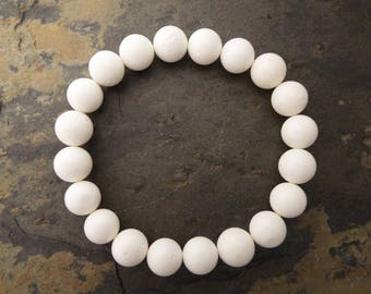 Matte off white coral bead bracelet on elastic band, Sponge bleached coral beads