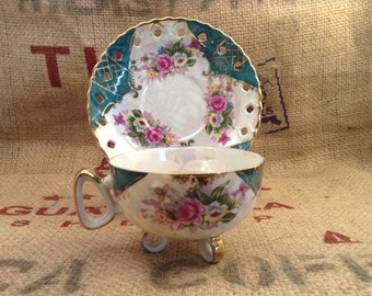 Beautiful teal and gold floral footed tea cup and saucer  marked P.B. exclusive import