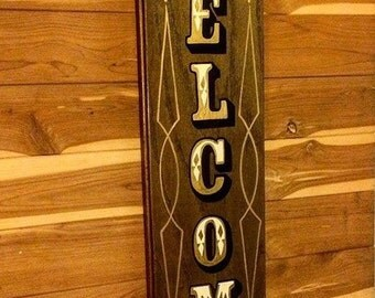 "Hand painted wood ""welcome"" sign."