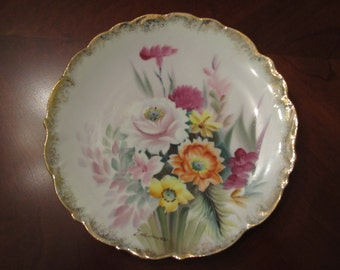 gorgeous hand painted and signed floral plate with gold trim/ 8 and 1/4 inch
