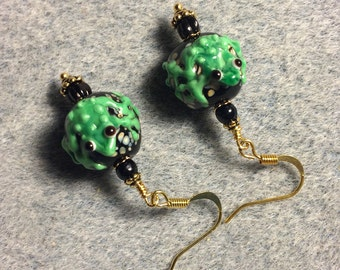 Black and bright green lampwork frog bead earrings adorned with black Czech glass beads.