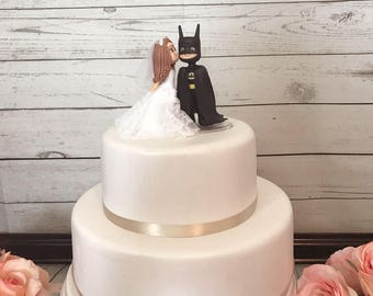 Cute Bride Kissing Batman Wedding Cake Topper