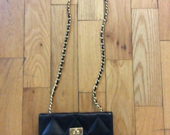 Black purse with chain
