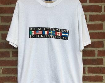 Vintage BUM equipment t shirt B.U.M. International made in USA flags