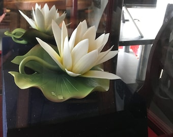 Signed lotus sculpture in redwood case