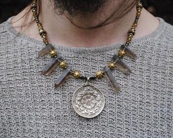 Pendant necklace with smoky quartz and tibetan calendar pendant