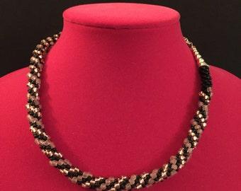 Pink black spiral Kumihimo necklace.