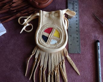 Deerskin fringed pouch , palomino colour with Appliqué of Four directions