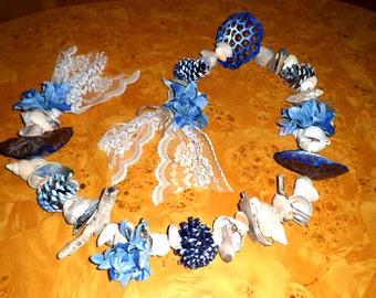 CHRISTMAS GARLAND. blue shell and driftwood garland.