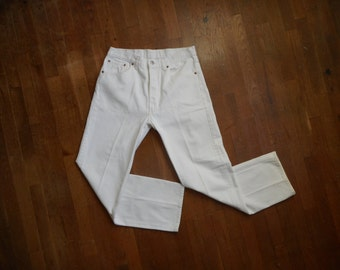 vintage levis 501 white denim jeans red tab silver tab button fly high waist W32 L30 made in usa