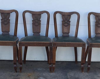 Unusual European Carved Oak and Leather Dining Chairs