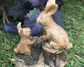 Miniature Brown Bunnies on a Stump