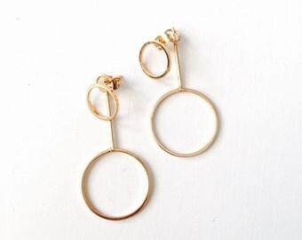 Uneven dangle hoop earrings