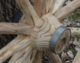 """42"""" Wagon wheels for sale. Torched to raise the grain, fire forged steel rims. Very solid and rustic."""