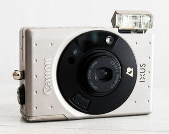 Canon IXUS - functional vintage compact analog point&shoot APS film camera, Wide zoom lens, Built-in flash, QuartzDate, Metal body