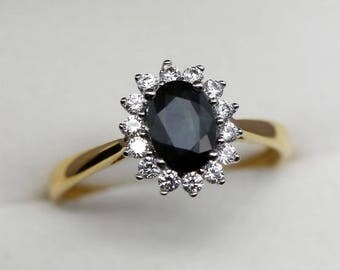 T52 Daisy ring in solid gold 9k set with a natural blue sapphire 1.06ct 1.48g
