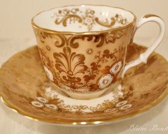 Antique English tea cup and saucer, with beautiful gold gilding