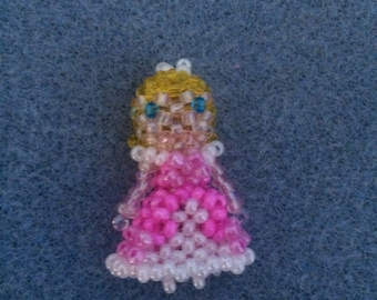 Cinderella (pre ugly step sister) doll pendant.