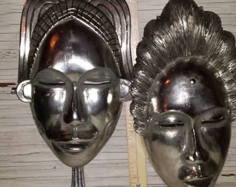 "Art Deco Figural Wall Mountable Masks. One is 14 1/2"" while the other is 12"". A composite Material that has a Metallic Finish.Ready to mount"