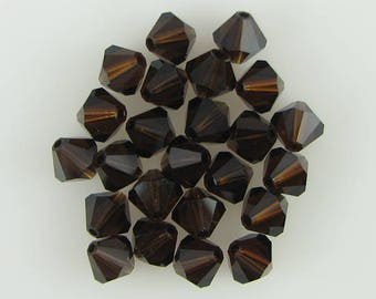 24 6mm Swarovski crystal bicone 5301 Mocca beads 3915