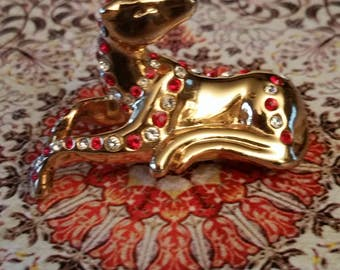 Small gold tone sitting dog with rhinestones