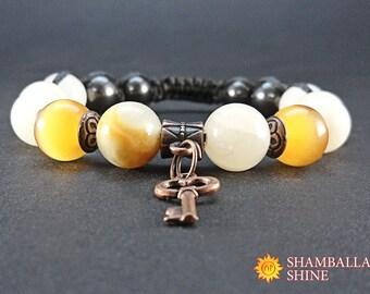 Yellow charm bracelet Natural onyx gemstone Gift for wife Copper key charm Meditation stone jewelry Yellow natural stone Pendant key jewelry