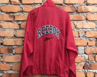 Vintage REEBOK Big Logo and spellout windbreaker jacket