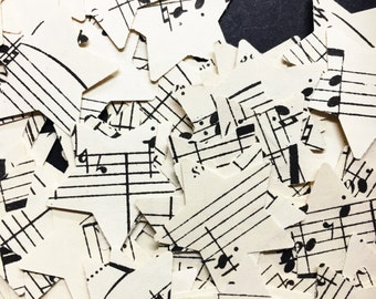 100 stars made from vintage music sheets , cardmaking , confetti , scrapbooks , embellishments , smashbooks