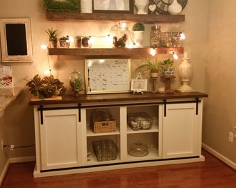 handcrafted buffet table with exposed sliding door hardware