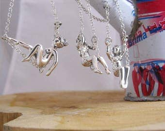 Female sculpture swing necklace - 3 options