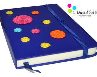 Blue notebook with coloured crochet dots