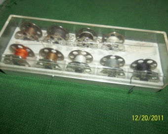 sewing machine bobbins in case- sears kenmore